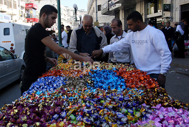 A Palestinian vendor displays sweets at his shop in the West Bank city Nablus on Wednesday, Nov. 2, 2011, ahead of the Muslim holiday of Eid al-Adha or Feast of the Sacrifice, which marks the end of the annual hajj or pilgrimage to Mecca and is celebrated in remembrance of Abraham's readiness to sacrifice his son to God. Photo by Wagdi Eshtayah