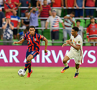 AUSTIN, TX - JULY 29: Reggie Cannon #2 of the United States brings the ball up the field with Homam Ahmed #14 right with him during a game between Qatar and USMNT at Q2 Stadium on July 29, 2021 in Austin, Texas.