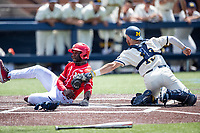 Maryland Terrapins outfielder Chris Alleyne (11) is tagged out by Michigan Wolverines catcher Griffin Mazur (13) at the plate on May 23, 2021 in NCAA baseball action at Ray Fisher Stadium in Ann Arbor, Michigan. Maryland beat the Wolverines 7-3. (Andrew Woolley/Four Seam Images)