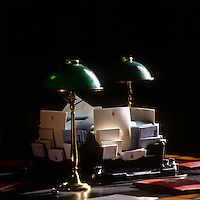 One of the library desks with House of Lord's stationery with the distinctive green reading lamps, which stand on every table