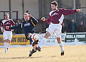 Albion's Barry Russell blocks Arbroath's Daniel Rennie's shot.