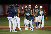 Alexander Ovalles (26) of the Charleston Boiled Peanuts celebrates with teammates after their win over the Augusta GreenJackets at Joseph P. Riley, Jr. Park on June 26, 2021 in Charleston, South Carolina. (Brian Westerholt/Four Seam Images)