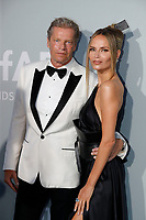 CAP D'ANTIBES, FRANCE - JULY 16:  Peter Bakker and Natasha Poly at the amfAR Cannes Gala 2021 during the 74th Annual Cannes Film Festival at Villa Eilenroc on July 16, 2021 in Cap d'Antibes, France. <br /> CAP/GOL<br /> ©GOL/Capital Pictures