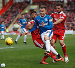 Barrie McKay gets past Shay Logan and Graeme Shinnie