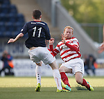 Ziggy Gordon goes in strongly on Falkirk's Conor McGrandles and is lucky to only get a yellow card