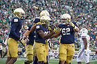 Sept. 26, 2015; Running back Josh Adams celebrates his 70-yard touchdown with teammates in the fourth quarter against the University of Massachusetts at Notre Dame Stadium. (Photo by Barbara Johnston/University of Notre Dame)
