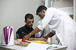 DOMIZ, IRAQ: A nurse from the NGO Doctors Without Borders treats a Syrian refugee in the Domiz refugee camp...Over 7,000 Syrian Kurds have fled the violence in Syria and are living in the Domiz refugee camp in the semi-autonomous region of Iraqi Kurdistan...Photo by Ali Arkady/Metrography