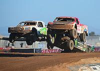 Apr 16, 2011; Surprise, AZ USA; LOORRS driver Rodrigo Ampudia (36) jumps alongside Jeff Geiser (44) during round 3 at Speedworld Off Road Park. Mandatory Credit: Mark J. Rebilas-