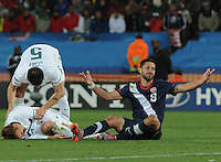 Clint Dempsey questions another decision by Mail referee Koman Coulibaly. The United States came from a 2-0 halftime deficit to Slovenia to earn a 2-2 draw their second match of play in Group C of the 2010 FIFA World Cup.