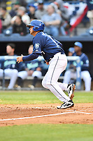 Asheville Tourists second baseman Coco Montes (5) runs to first base during a game against the Augusta GreenJackets at McCormick Field on April 4, 2019 in Asheville, North Carolina. The GreenJackets defeated the Tourists 9-5. (Tony Farlow/Four Seam Images)