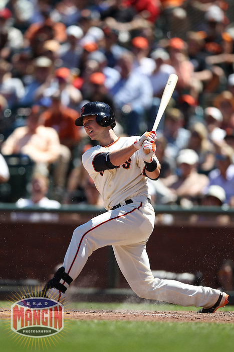 SAN FRANCISCO - JUNE 10:  Buster Posey of the San Francisco Giants bats during the game against the Texas Rangers at AT&T Park on June 10, 2012 in San Francisco, California. (Photo by Brad Mangin)