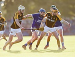 Podge Collins of Ballyea in action against Brandon O Connell and Brian Carrig of  Cratloe during the county senior hurling final at Cusack Park. Photograph by John Kelly.