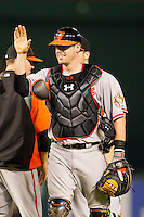 Baltimore Orioles catcher Matt Wieters #32 celebrates the win following the Major League Baseball game against the Texas Rangers on August 21st, 2012 at the Rangers Ballpark in Arlington, Texas. The Orioles defeated the Rangers 5-3. (Andrew Woolley/Four Seam Images).