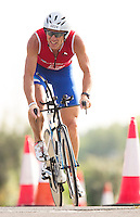28 JUL 2013 - LONDON, GBR - Former British elite triathlete Richard Hobson negotiates the bike route during the 2013 Virgin Active London Triathlon in the Royal Victoria Dock in London, Great Britain  (PHOTO COPYRIGHT © 2013 NIGEL FARROW, ALL RIGHTS RESERVED)
