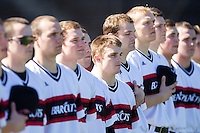 Ethan McAlpine (center) and his Cincinnati Bearcats teammates stand for the National Anthem prior to the game against the Radford Highlanders at Wake Forest Baseball Park on February 22, 2014 in Winston-Salem, North Carolina.  The Highlanders defeated the Bearcats 6-5.  (Brian Westerholt/Four Seam Images)