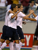 Josh Wolff and Bobby Convey celebrate Brian Ching's goal against Venezuela in the 36th minute. USA (2) vs Venezuela (0) at Browns Stadium in Cleveland, Ohio, May 26, 2006.
