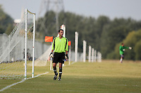 A Sunday morning goalkeeper is seen in front of a long line of goalposts at Hackney Marshes - 20/09/09 - MANDATORY CREDIT: Gavin Ellis/TGSPHOTO - Self billing applies where appropriate - Tel: 0845 094 6026