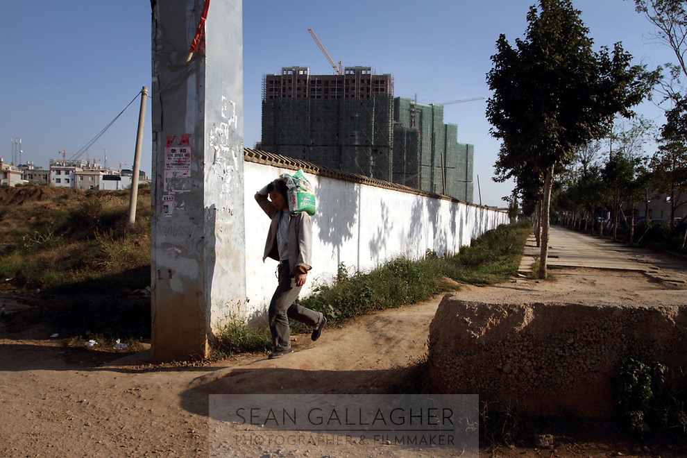 New developments loom over Zijun village, home of the Samatao minority.