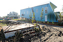 New houses by Brad Pitt and the Make It Right Foundation are a tourist attraction in the Hurricane Katrina devastated Lower Ninth Ward, New Orleans, Thurs., Nov. 19, 2009.