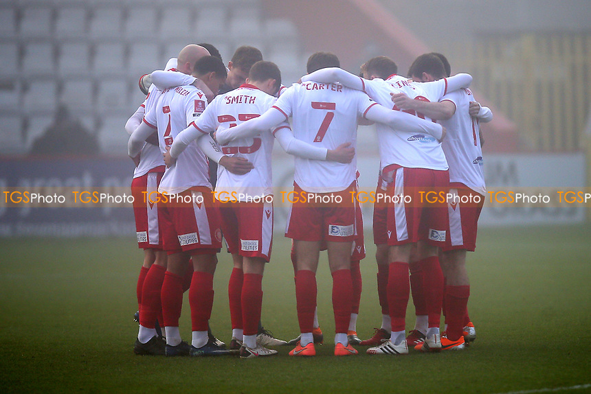 Stevenage players huddle during Stevenage vs Swansea City, Emirates FA Cup Football at the Lamex Stadium on 9th January 2021