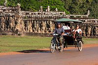 Cambodia, Angkor Thom.  Motorcycle-powered Taxi Going Past the Elephant Terrace.
