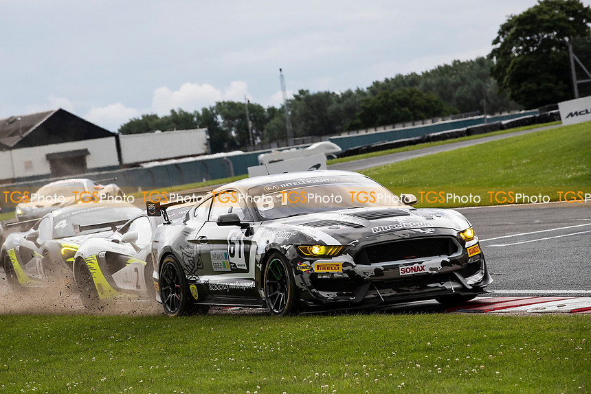 Will Moore & Matt Cowley, Ford Mustang GT4, Academy Motorsport gets a little wide out of Goddards during the British GT & F3 Championship on 11th July 2021