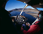 Interior of a Bell Jet Ranger Helicopter flying at low level over Lake Wanaka. Otago New Zealand.