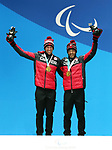 Brian McKeever and Russell Kennedy, PyeongChang 2018 - Para Nordic Skiing // Ski paranordique.<br /> Brian McKeever and guide Russell Kennedy receive their gold medals // Brian McKeever et guide Russell Kennedy remporte leurs médailles d'or. 14/03/2018.