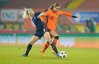 BREDA, NETHERLANDS - NOVEMBER 27: Julie Ertz #8 of the United States battles with Jill Roord #19 of the Netherlands during a game between Netherlands and USWNT at Rat Verlegh Stadion on November 27, 2020 in Breda, Netherlands.
