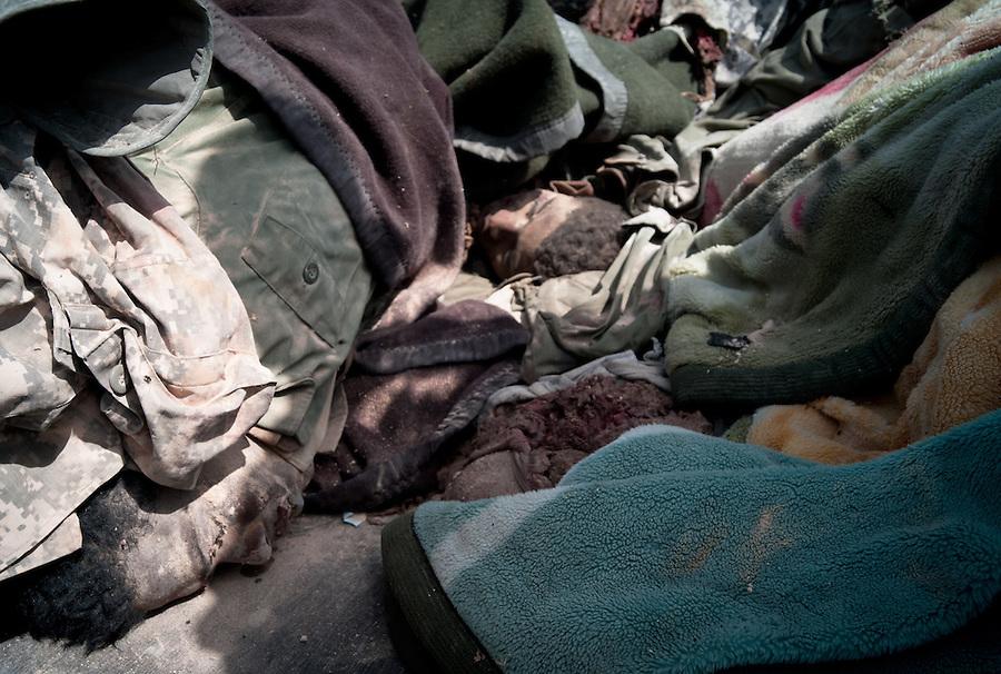 Suspected Gaddafi mercinaries are bought to the morgue at Ajdabiya, Libya
