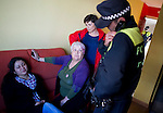 Ecuadorian homeowner Kelly Herrera (L) closes her eyes as a psychologist speaks on March 13, 2012 with police coming to evict her from her house in Madrid. Spain on March 9 approved a new voluntary 'code of conduct' for banks which aims to help poor homeowners settle their debts and reduce a wave of evictions brought on by the economic crisis. Spanish banks currently seize the homes of those who default on their mortgages and often demand further payment from those evicted if the value of the house has fallen below that of the loan. The new rules will apply in cases where every member of a household is unemployed and mortgage payments are equal to more than 60 percent of their income. (c) Pedro ARMESTRE
