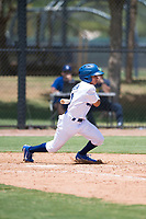 AZL Dodgers pinch hitter Jeremiah Vison (10) follows through on his swing during an Arizona League game against the AZL Padres 2 at Camelback Ranch on July 4, 2018 in Glendale, Arizona. The AZL Dodgers defeated the AZL Padres 2 9-8. (Zachary Lucy/Four Seam Images)