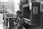 A Japanese woman in kimono smokes before she enters the hall for a coming-of-age ceremony in Toyoka City Hall. In Japan, in every January, men and women who become 20 years old celebrate the ceremony in each city hall where they grew up.<br /> <br /> Une Japonaise en kimono fume avant d'entrer dans la salle pour une cérémonie du passage à l'âge adulte à la mairie de Toyoka. Au Japon, chaque année en janvier, des hommes et des femmes âgés de 20 ans célèbrent la cérémonie dans chaque hôtel de ville où ils ont grandi.