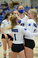 Rogers' Kate Miller (right) is congratulated Tuesday, Oct. 13, 2020, by Camiran Brockhoff (1) and Ella McLeod after a first-set win during play against Bentonville in King Arena in Rogers. Visit nwaonline.com/201014Daily/ for today's photo gallery. <br /> (NWA Democrat-Gazette/Andy Shupe)