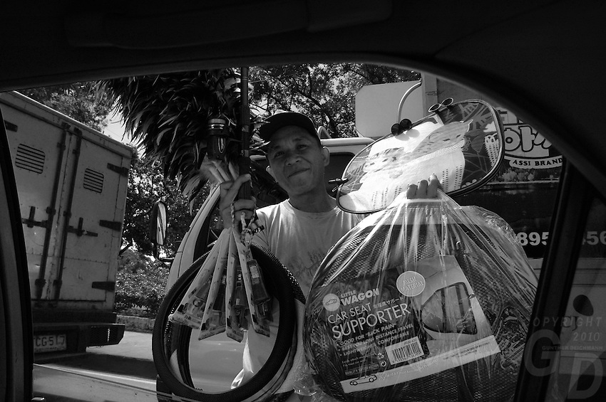 A Street vendor selling car accessories view from the car window Manila, Philippines