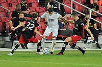 WASHINGTON, DC - SEPTEMBER 27: Gustavo Bou #7 of New England Revolution battles for the ball with Griffin Yow #22 and Frederic Brilliant #13 of D.C. United during a game between New England Revolution and D.C. United at Audi Field on September 27, 2020 in Washington, DC.