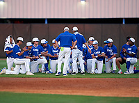 IMG Academy Ascenders team meeting after a game against the Montverde Academy Eagles on April 8, 2021 at IMG Academy in Bradenton, Florida.  (Mike Janes/Four Seam Images)