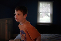 Jack Ursitti, age 7, poses for a portrait in his home in Dover, Mass., on Monday, July 25, 2011. Jack has been diagnosed with autism.  After school at his home, Jack works with his teacher and a therapist to do educational and independent leisure activities...Jack Ursitti wears a small GPS ankle bracelet at all times in case he runs off from his family or caretakers. The device will be activated if he goes missing, allowing police and other searchers to find him.