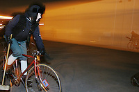 """People playing the sport of """"urban bike polo"""" in Brooklyn, NY on March 10, 2004 on a traditional handball court."""