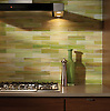 """This custom kitchen features a handmade 2"""" x 8"""" Brick backsplash shown in Peridot jewel glass from New Ravenna. <br /> <br /> For pricing samples and design help, click here: http://www.newravenna.com/showrooms/"""