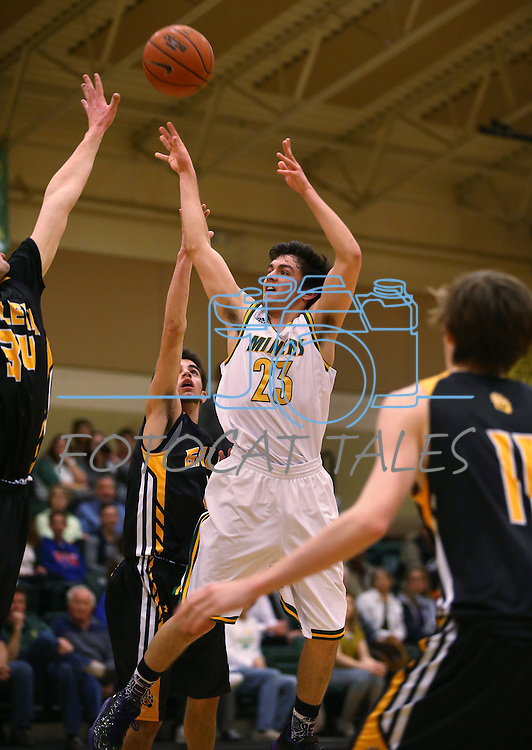 Manogue's James Sandoval shoots over the Galena defense at Manogue High School in Reno, Nev., on Tuesday, Feb. 11, 2014. Manogue won 66-59.<br /> Photo by Cathleen Allison