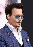 """WESTWOOD, LOS ANGELES, CA, USA - APRIL 10: Johnny Depp at the Los Angeles Premiere Of Warner Bros. Pictures And Alcon Entertainment's """"Transcendence"""" held at Regency Village Theatre on April 10, 2014 in Westwood, Los Angeles, California, United States. (Photo by Xavier Collin/Celebrity Monitor)"""