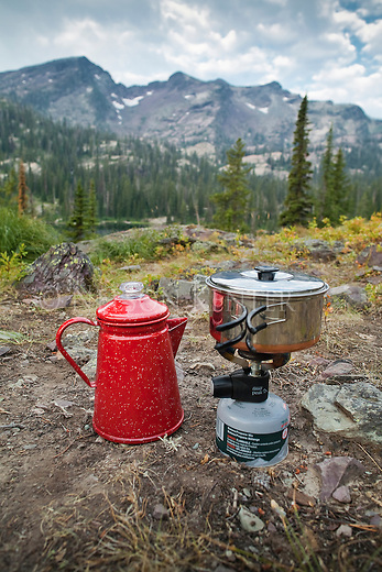A backpacker's cooking set up with a red coffee pot at Island Lake in the Seeley Swan area of western Montana
