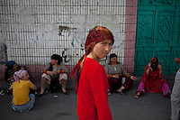 Women sit around in a Uighur neighbourhood in Urumqi.