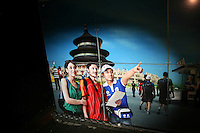 CHINA. Beijing. A picture of an Olympic volunteer helping foreign tourists . 2008