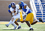 BROOKINGS, SD - APRIL 24: Holy Cross Crusaders defensive back Tyler Purdy #20 is brought down by a pair of defenders from the South Dakota State Jackrabbits at Dana J Dykhouse Stadium on April 24, 2021 in Brookings, South Dakota. (Photo by Dave Eggen/Inertia)