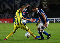 BOGOTA - COLOMBIA - 01 – 04 - 2018: Cristian Huerfano (Der.) jugador de Millonarios disputa el balón con Jefferson Torres (Izq.) jugador de Atletico Bucaramanga, durante partido de la fecha 12 entre Millonarios y por la Liga Aguila I 2018, jugado en el estadio Nemesio Camacho El Campin de la ciudad de Bogota. / Cristian Huerfano (R) player of Millonarios vies for the ball with Jefferson Torres (L) player of Atletico Bucaramanga, during a match of the 12th date between Millonarios and Atletico Bucaramanga, for the Liga Aguila I 2018 played at the Nemesio Camacho El Campin Stadium in Bogota city, Photo: VizzorImage / Luis Ramirez / Staff.