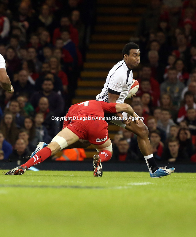 Pictured L-R: Justin Tipuric of Wales brings Waisea Nayacalevu of Fiji down. Saturday 15 November 2014<br /> Re: Dove Men Series rugby, Wales v Fiji at the Millennium Stadium, Cardiff, south Wales, UK.