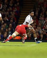 Pictured L-R: Justin Tipuric of Wales brings Waisea Nayacalevu of Fiji down. Saturday 15 November 2014<br />