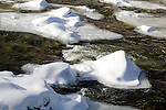 The snow-covered Wild River rushes through the White Mountain National Forest in Gilead, ME